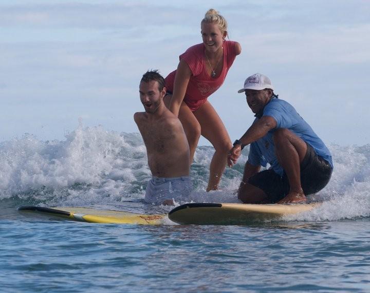 Ник Вуйчич на серфинге